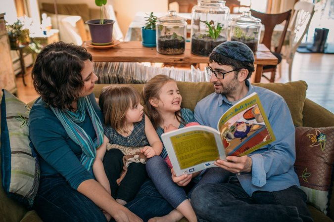 Family reading a PJ Library Passover book